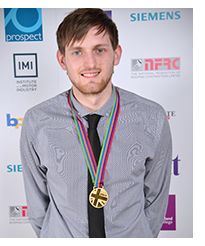 Image of Callum Byrne with his medal from the World Skills Competition