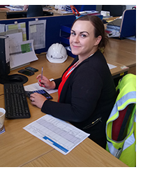 former student Hollie Markham at her workplace