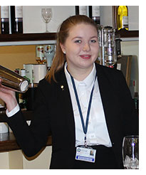 Samantha Kennett behind the bar of the College's Parc's Restaurant