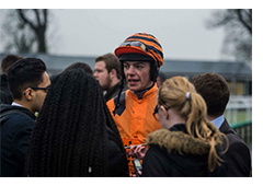 Image shows Molly on the right hand side interviewing a jockey at the Uttoxeter Races